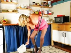 cleaning the kitchen in hose gets mommy all