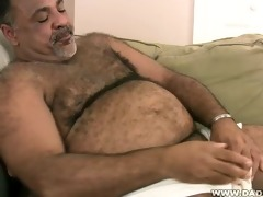 stocky dad plays with his rod