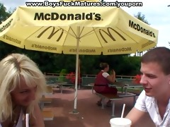 mature bends over for doggy fuck in public