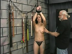 cute youthful brunette is restrained and made to