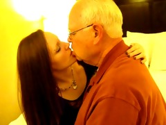 hot woman giving a kiss a 82 year old chap