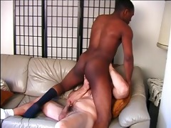 darksome guy enjoys a large white cock in his